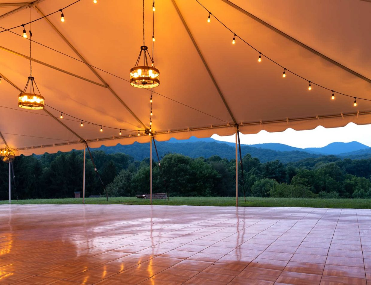 lighted wedding tent at our wedding venue near Asheville