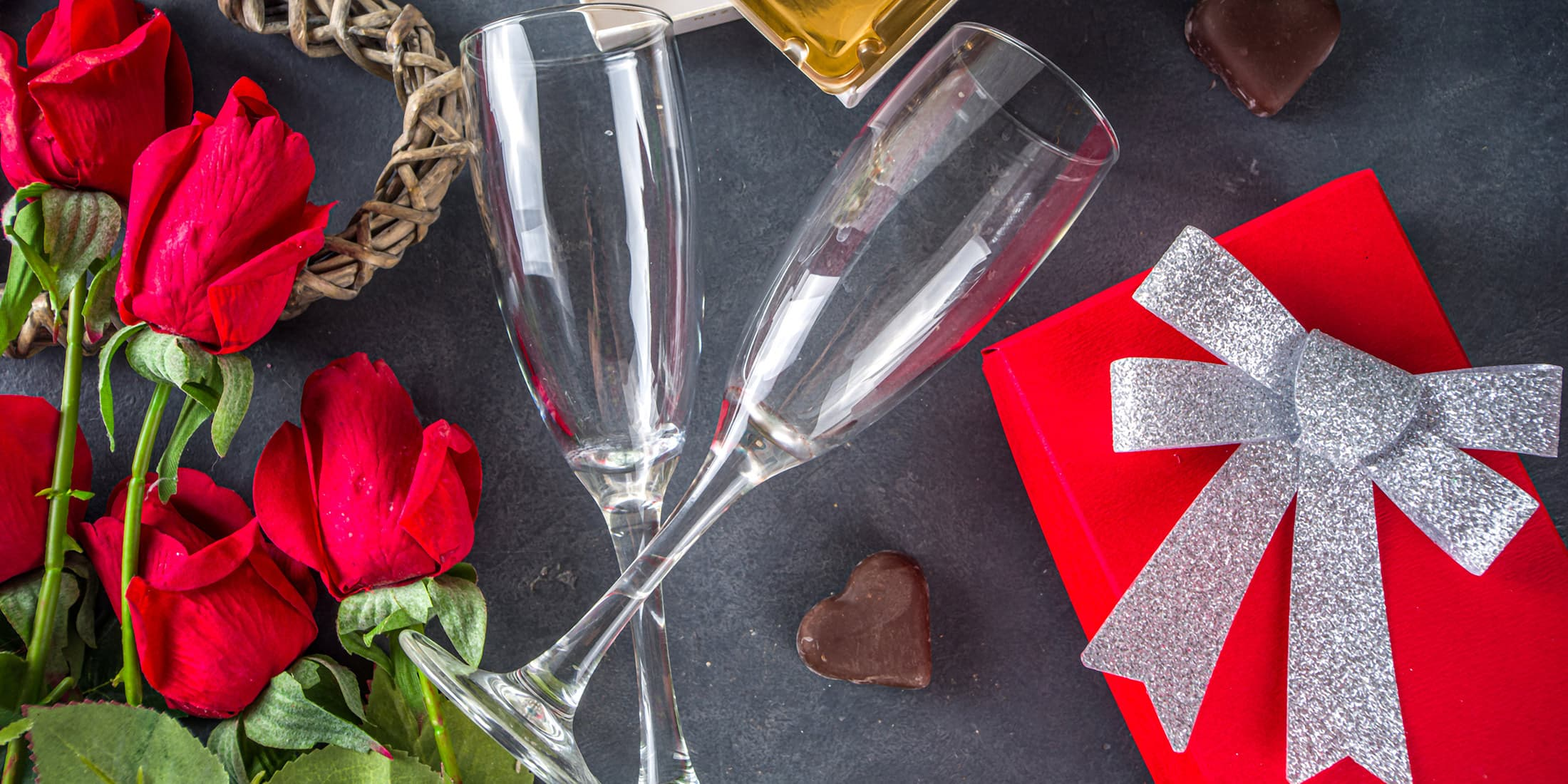 romantic getaway package with roses and wine glasses