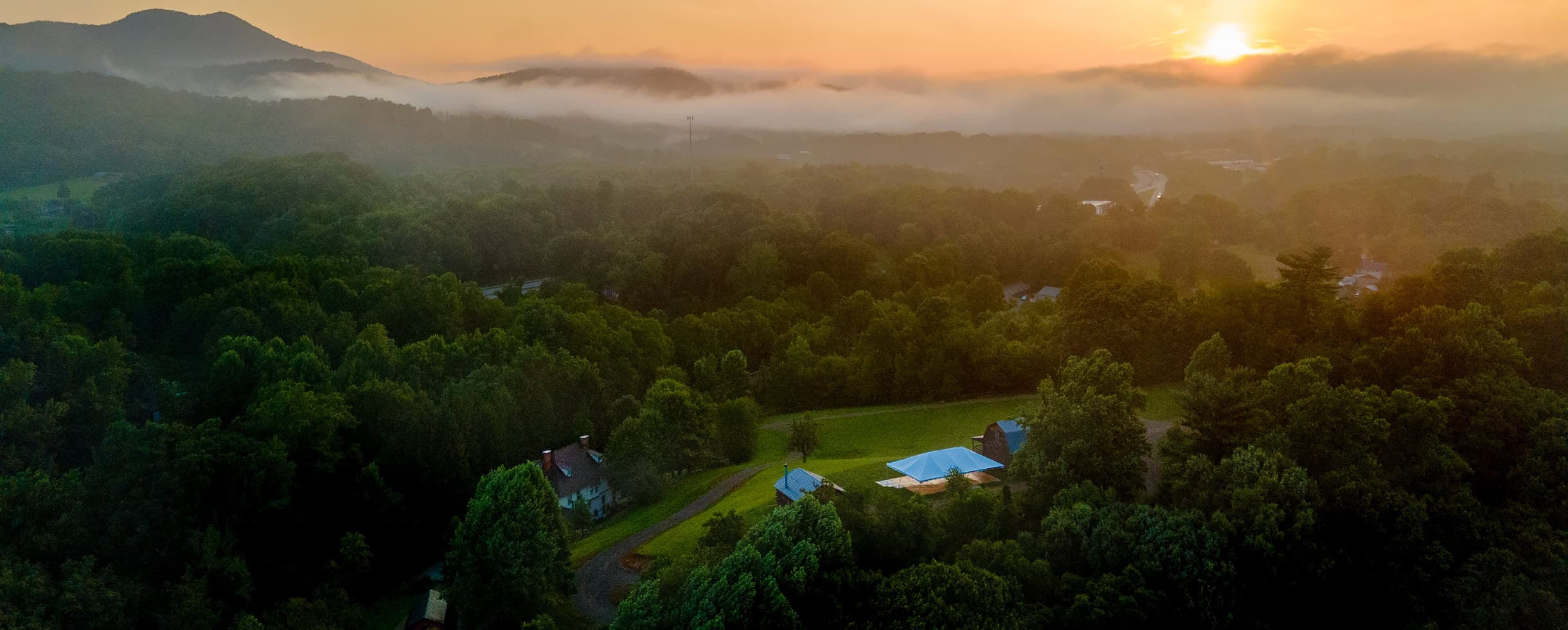 aerial view of the property at sunrise