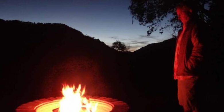man by fire pit at Smoky Mountain resort